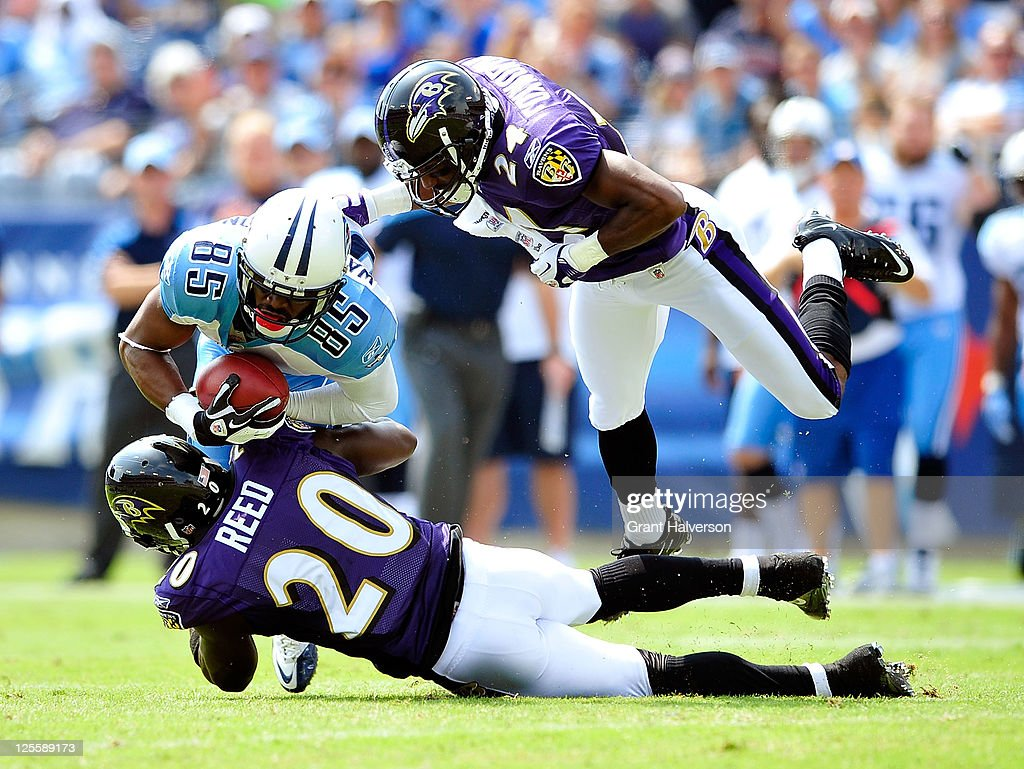 <a gi-track='captionPersonalityLinkClicked' href=/galleries/search?phrase=Ed+Reed+-+American+Football+Player&family=editorial&specificpeople=194933 ng-click='$event.stopPropagation()'>Ed Reed</a> #20 and Domonique Foxworth #24 of the Baltimore Ravens tackle <a gi-track='captionPersonalityLinkClicked' href=/galleries/search?phrase=Nate+Washington&family=editorial&specificpeople=748657 ng-click='$event.stopPropagation()'>Nate Washington</a> #85 of the Tennessee Titans during the first half at LP Field on September 18, 2011 in Nashville, Tennessee.