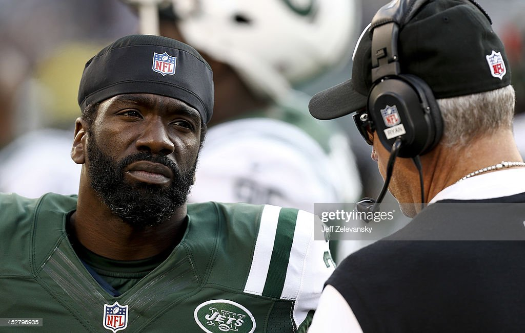 <a gi-track='captionPersonalityLinkClicked' href=/galleries/search?phrase=Ed+Reed&family=editorial&specificpeople=194933 ng-click='$event.stopPropagation()'>Ed Reed</a> #22 o the New York Jets talks with head coach <a gi-track='captionPersonalityLinkClicked' href=/galleries/search?phrase=Rex+Ryan&family=editorial&specificpeople=2358658 ng-click='$event.stopPropagation()'>Rex Ryan</a> of the New York Jets during their game against the Miami Dolphins at MetLife Stadium on December 1, 2013 in East Rutherford, New Jersey.