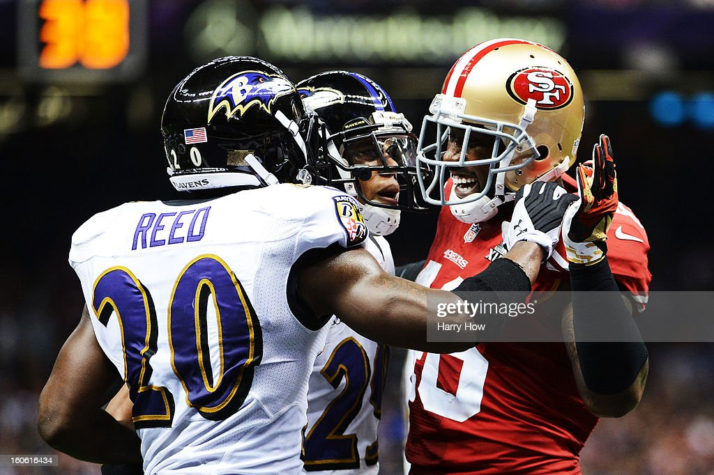Ed Reed #20 of the Baltimore Ravens and Delanie Walker #46 of the San Francisco 49ers exchange words in the second quarter during Super Bowl XLVII at the Mercedes-Benz Superdome on February 3, 2013 in New Orleans, Louisiana.