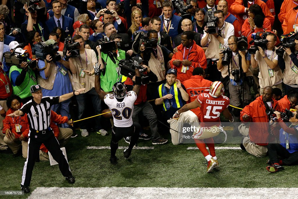 Ed Reed #20 of the Baltimore Ravens and Michael Crabtree #15 of the San Francisco 49ers react after Crabtree couldn't make a catch on a pass on a fourth down play to turn the ball over in the fourth quarter during Super Bowl XLVII at the Mercedes-Benz Superdome on February 3, 2013 in New Orleans, Louisiana. The Ravens won 34-31.