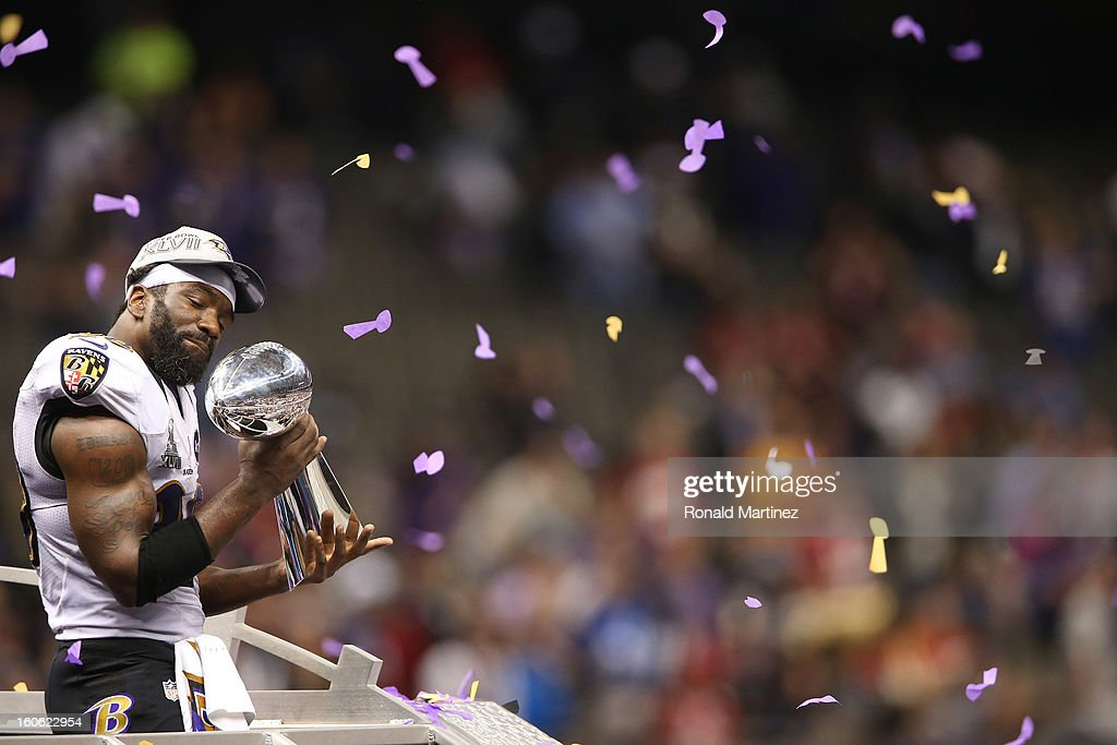 <a gi-track='captionPersonalityLinkClicked' href=/galleries/search?phrase=Ed+Reed&family=editorial&specificpeople=194933 ng-click='$event.stopPropagation()'>Ed Reed</a> #20 of the Baltimore Ravens celebrates with the Vince Lombardi trophy after the Ravens won 34-31 against the San Francisco 49ers during Super Bowl XLVII at the Mercedes-Benz Superdome on February 3, 2013 in New Orleans, Louisiana.