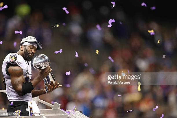 Ed Reed of the Baltimore Ravens celebrates with the Vince Lombardi trophy after the Ravens won 3431 against the San Francisco 49ers during Super Bowl...