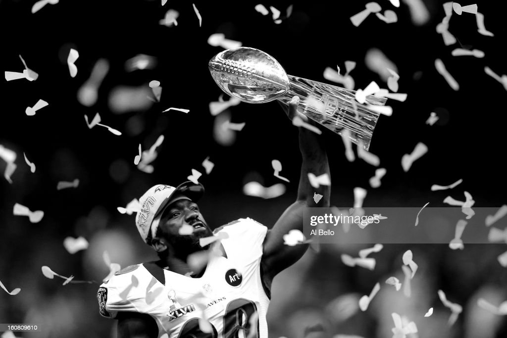 Ed Reed #20 of the Baltimore Ravens celebrates with the Vince Lombardi Championship trophy as confetti falls after the Ravens won 34-31 against the San Francisco 49ers during Super Bowl XLVII at the Mercedes-Benz Superdome on February 3, 2013 in New Orleans, Louisiana.