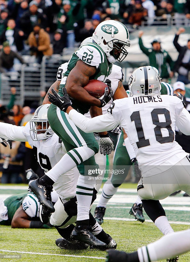 <a gi-track='captionPersonalityLinkClicked' href=/galleries/search?phrase=Ed+Reed&family=editorial&specificpeople=194933 ng-click='$event.stopPropagation()'>Ed Reed</a> #22 of the New York Jets intercepts a pass against <a gi-track='captionPersonalityLinkClicked' href=/galleries/search?phrase=Andre+Holmes&family=editorial&specificpeople=7536989 ng-click='$event.stopPropagation()'>Andre Holmes</a> #18 of the Oakland Raiders on December 8, 2013 at MetLife Stadium in East Rutherford, New Jersey. The Jets defeated the Raiders 37-27.