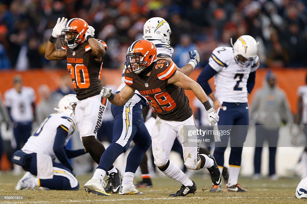 Ed Reynolds #39 and Briean Boddy-Calhoun #20 of the Cleveland Browns react after defeating the San Diego Chargers 20-17 at FirstEnergy Stadium on December 24, 2016 in Cleveland, Ohio.