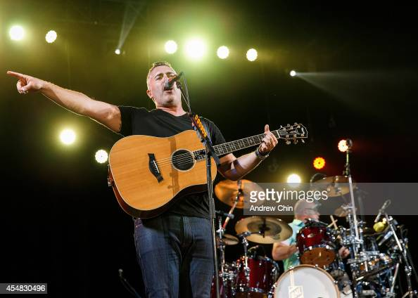 Ed Robertson and Tyler Stewart of Barenaked Ladies perform on stage at Malkin Bowl in Stanley Park on September 6 2014 in Vancouver Canada
