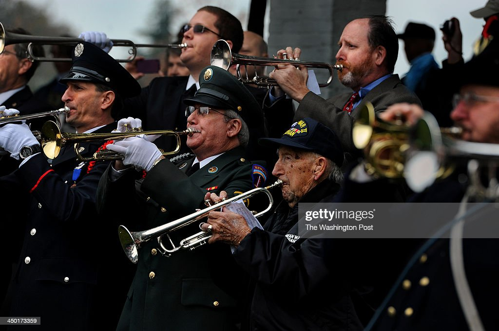 Ed Ruffennach, age 92, (older man, center, lower right) from Bridgeville, PA, was one of the more than one-hundred buglers who took part today. He's a WWII vet who served in Europe. Over 100 buglers participated in 'A Bugle Call Remembered: Taps at the Funeral of President John F. Kennedy,' at Arlington National Cemetery today. The buglers from over two dozen U.S. states converged to participate in the event to honor the 50th anniversary of the funeral for JFK. They met up as a group at the Old Amphitheater early in the day and played together before spreading out over various spots on the grounds at 12:00 noon so as to play taps in unison for all of the citizens buried there.