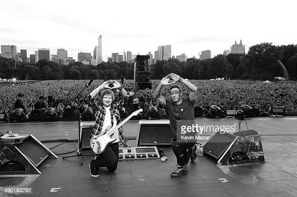 Ed Sheeran and Chris Martin pose onstage during 2015 Global Citizen Festival to end extreme poverty by 2030 in Central Park on September 26 2015 in...