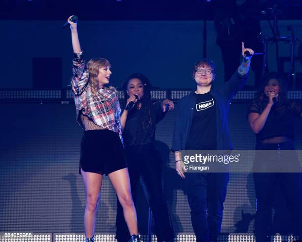 Ed Sheeran joins Taylor Swift onstage during the 997 NOW POPTOPIA at SAP Center on December 2 2017 in San Jose California