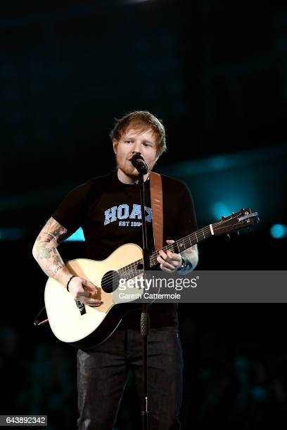 Ed Sheeran performs on stage at The BRIT Awards 2017 at The O2 Arena on February 22 2017 in London England