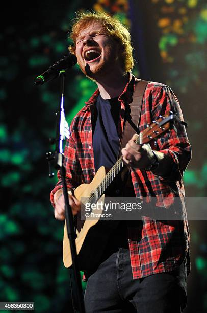Ed Sheeran performs on stage during the iTunes Festival at The Roundhouse on September 29 2014 in London United Kingdom