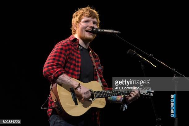 Ed Sheeran performs on the Pyramid Stage at the Glastonbury Festival of Music and Performing Arts on Worthy Farm near the village of Pilton in...