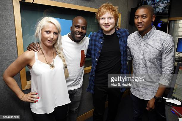 Ed Sheeran poses with KISS Breakfast presenters Charlie Hedges Rickie Haywood Williams and Melvin O'Doom as he visits Kiss FM Breakfast at Kiss FM's...