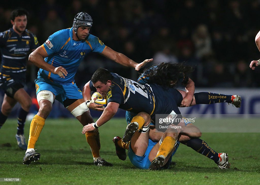 Ed Shervington of Worcester is stopped by the Wasps defence during the Aviva Premiership match between Worcester Warriors and London Wasps at Sixways Stadium on March 1, 2013 in Worcester, England.