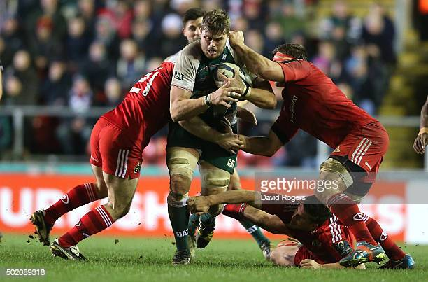 Ed Slater of Leicester is held by CJ Stander and Tomas O'Leary during the European Rugby Champions Cup match between Leicester Tigers and Munster at...