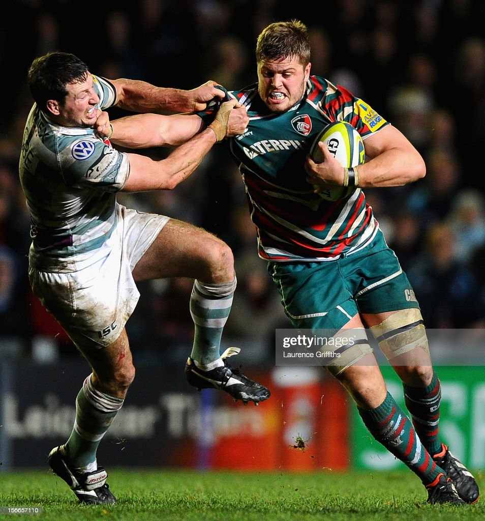 Ed Slater of Leicester Tigers is tackled by Declan Danaher of London Irish during the LV= Cup match between Leicester Tigers and London Irish at Welford Road on November 18, 2012 in Leicester, England.