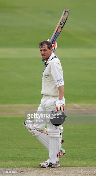 Ed Smith of Middlesex celebrates reaching his century during the first day of the Liverpool Victoria County Championship Division 1 match between...