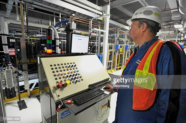 Ed Speckhardt senior engineer for Encore Automation works at an operator's console as robotic painting arms are tested at the underbody sealing and...