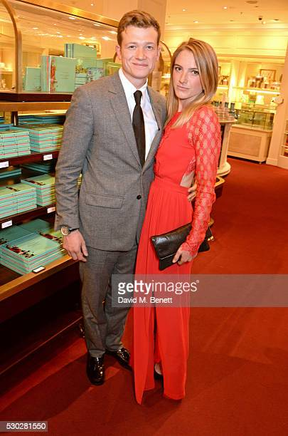 Ed Speleers and Asia Macey attend Fortnum Mason's postpremiere party for new release 'Alice Through the Looking Glass' at Fortnum Mason on May 10...