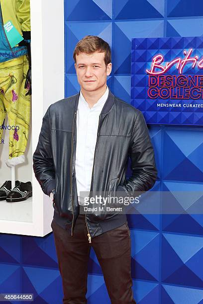 Ed Speleers attends the official opening of British Designers' Collective Menswear curated by GQ at Bicester Village on September 18 2014 in Bicester...