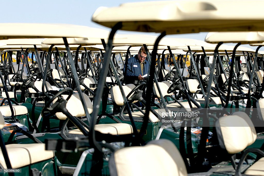 Ed Spencer looks at golf carts before a Ritchie Bros. Auctioneers Inc. industrial equipment auction in Dunnigan, California, U.S., on Thursday, May 20, 2010. More than 1,400 lots were offered during the multi-million dollar unreserved public auction through Ritchie Bros., the world's biggest auctioneer of industrial equipment. Photographer: Ken James/Bloomberg via Getty Images