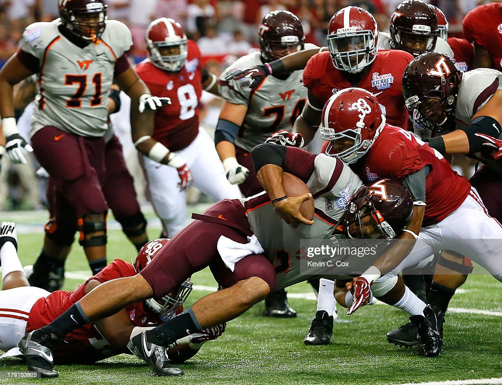 Ed Stinson #49 and Trey DePriest #33 of the Alabama Crimson Tide tackle <a gi-track='captionPersonalityLinkClicked' href=/galleries/search?phrase=Logan+Thomas&family=editorial&specificpeople=6787143 ng-click='$event.stopPropagation()'>Logan Thomas</a> #3 of the Virginia Tech Hokies at Georgia Dome on August 31, 2013 in Atlanta, Georgia.