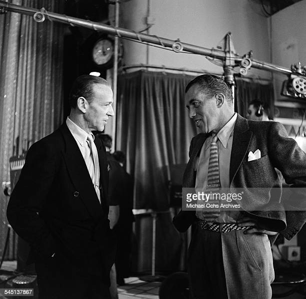 Ed Sullivan and Fred Astaire talk during rehearsals for the 'Toast of the Town' show hosted by Ed Sullivan at the Maxine Elliott Theater in New York...