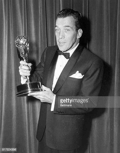 Ed Sullivan holding television 'Emmy' award
