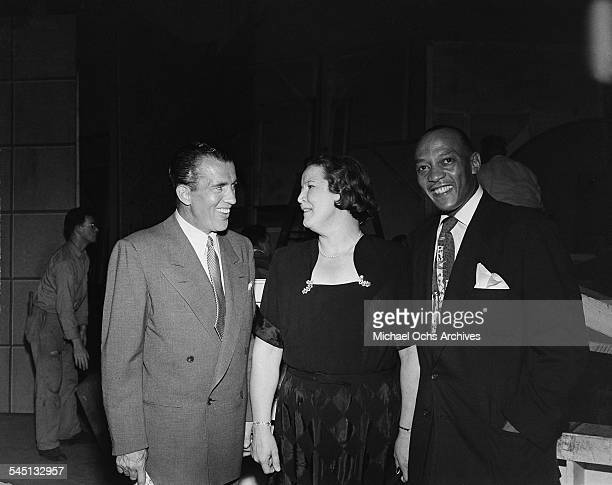 Ed Sullivan meets with Gertrude Etterly and Jesse Owens for the 'Toast of the Town' show hosted by Ed Sullivan at the Maxine Elliott Theater in New...