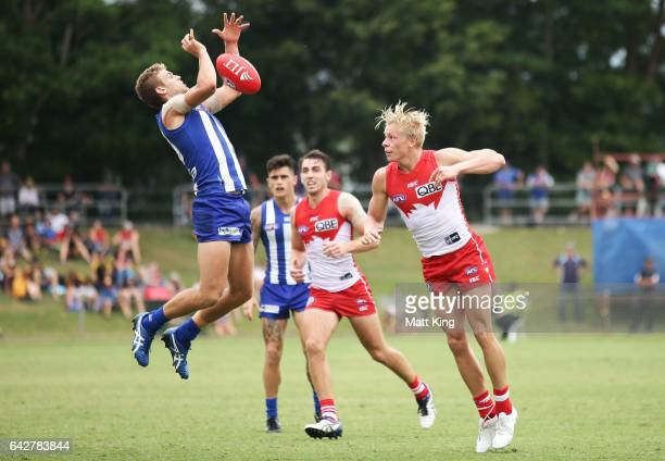 Ed VickersWillis of the Kangaroos is challenged by Isaac Heeney of the Swans during the 2017 JLT Community Series match between the Sydney Swans and...