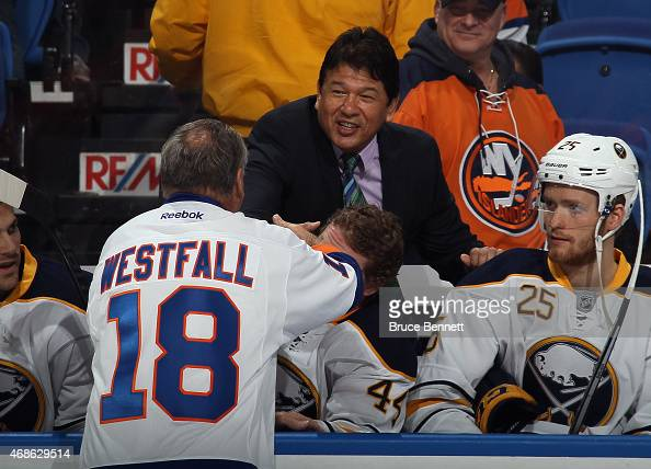 Ed Westfall says hello to head coach Ted Nolan of the Buffalo Sabres during the New York Islanders Decades Night prior to the game against the...