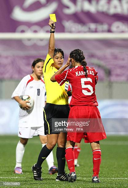 Eda Karatas of Turkey receives a yellow card from referee Pannipar Kamnueng during the semi final match between Chile and Turkey in the Girls Youth...