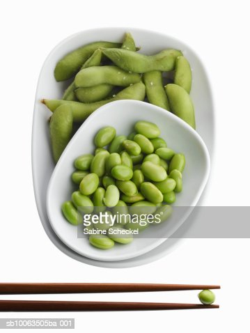Edamame in bowl with chopsticks, overhead view : Stock Photo