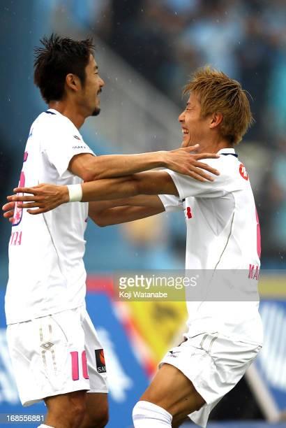 Edamura Takuma of Cerezo Osaka and Yoichiro Kakitani celebrate the first goal during the JLeague match between Kawasaki Frontale and Cerezo Osaka at...
