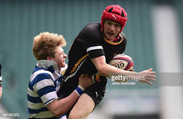 Edan Kelly of Wakefield is tackled by Will Tanner of Warwick during the NatWest Schools U15 Cup Final between Warwick School and Qegs Wakefield at...
