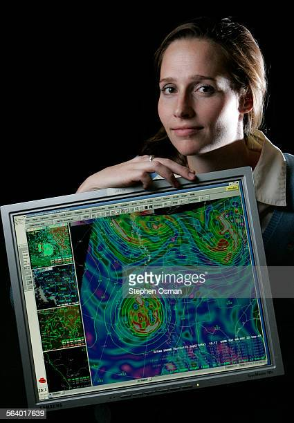 Edan Lindaman 25 a meteorologist with National Weather Service office in Oxnard holds a monitor displaying an image of the storm that is heading out...