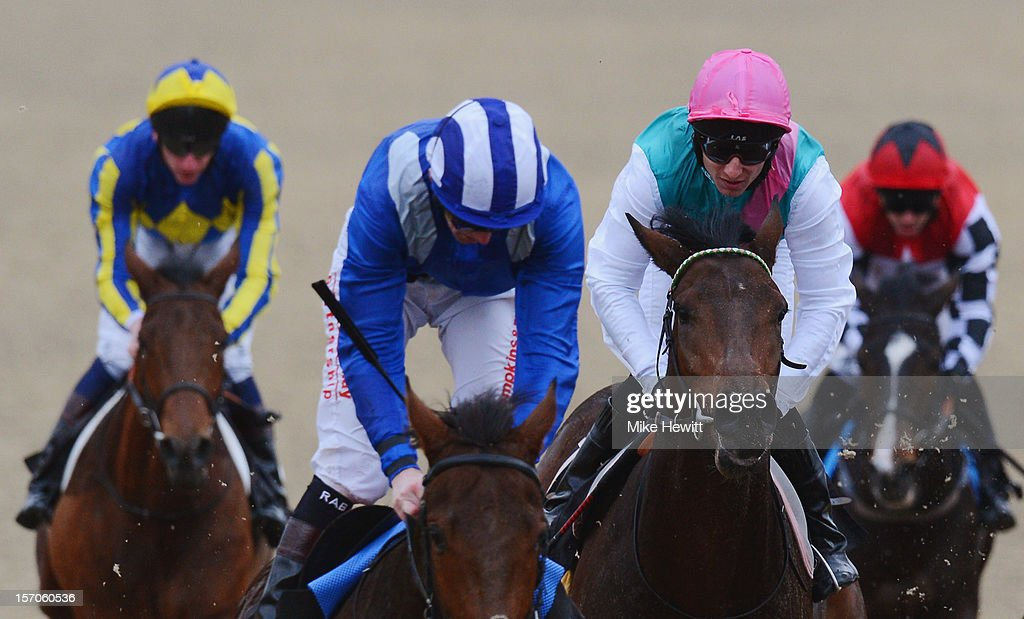 <a gi-track='captionPersonalityLinkClicked' href=/galleries/search?phrase=Eddie+Ahern&family=editorial&specificpeople=171359 ng-click='$event.stopPropagation()'>Eddie Ahern</a> on favourite Demonic (pink cap) finishes in fourth place in the British Stallion Studs Supporting British Racing E.B.F. Maiden Stakes (Div 2) at Lingfield Park on November 28, 2012 in Lingfield, England.