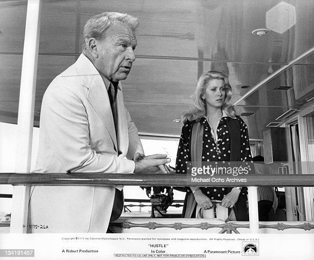 Eddie Albert muses about old times with long time friend Catherine Deneuve in a scene from the film 'Hustle' 1975