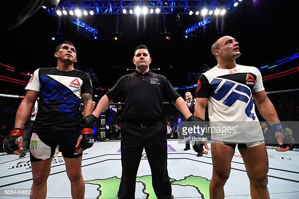 Eddie Alvarez and Anthony Pettis react as the judges' scores are read after their lightweight bout during the UFC Fight Night event inside TD Garden...