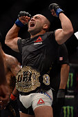Eddie Alvarez celebrates after defeating Rafael Dos Anjos of Brazil in their lightweight championship bout during the UFC Fight Night event inside...