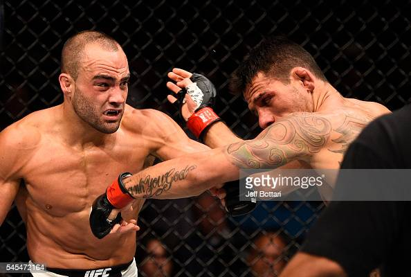 Eddie Alvarez connects with a left against Rafael Dos Anjos of Brazil in their lightweight championship bout during the UFC Fight Night event inside...