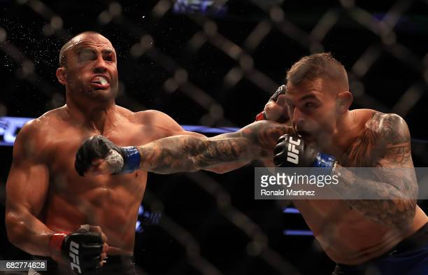 Eddie Alvarez fights against Dustin Poirier in their Lightweight bout during UFC 211 at American Airlines Center on May 13 2017 in Dallas Texas