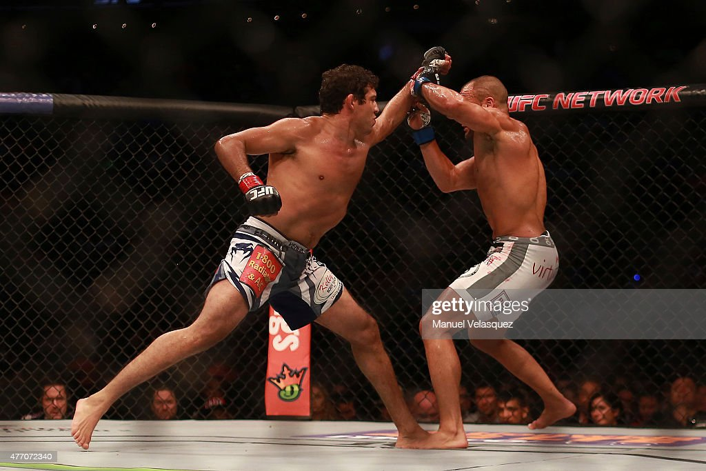 Eddie Alvarez (R) fights against Gilbert Melendez (L) during a UFC Lightweight Fight between Eddie Alvarez and Gilbert Melendez at Arena Ciudad de Mexico on June 13, 2015 in Mexico City, Mexico.