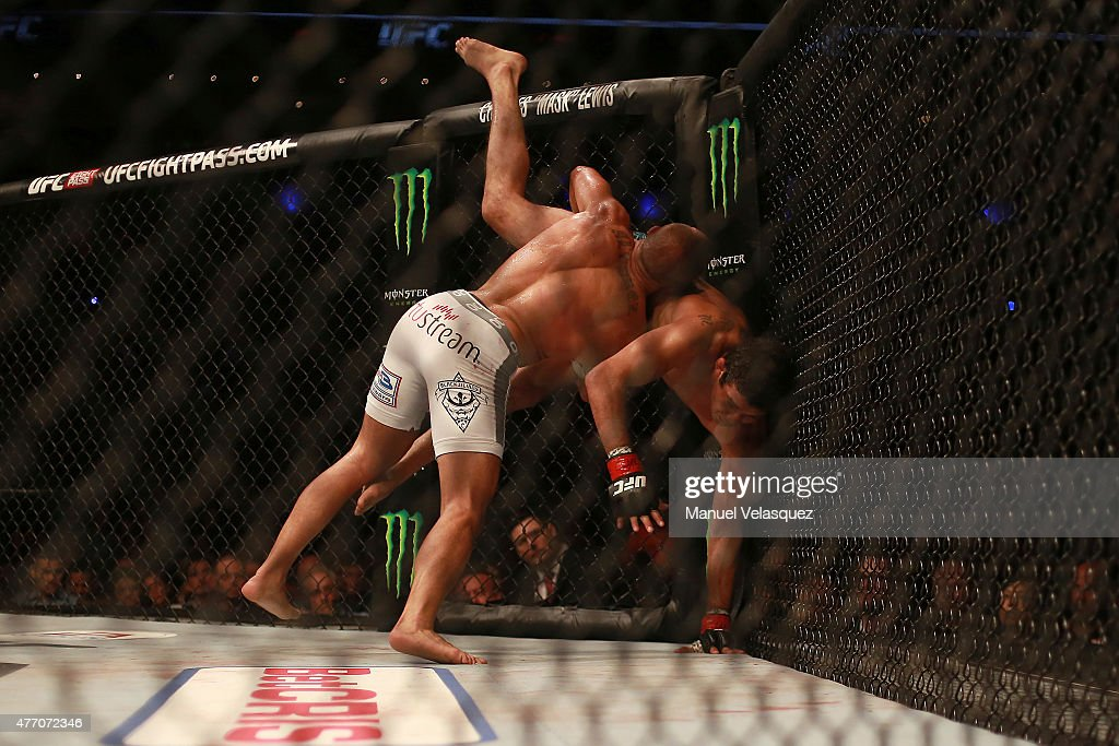 Eddie Alvarez (L) fights against Gilbert Melendez (R) during a UFC Lightweight Fight between Eddie Alvarez and Gilbert Melendez at Arena Ciudad de Mexico on June 13, 2015 in Mexico City, Mexico.