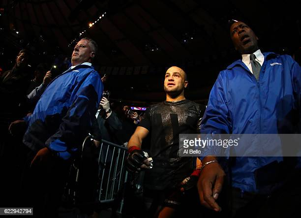 Eddie Alvarez of the United States heads to the octagon for his fight against Conor McGregor of Ireland in their lightweight championship bout during...