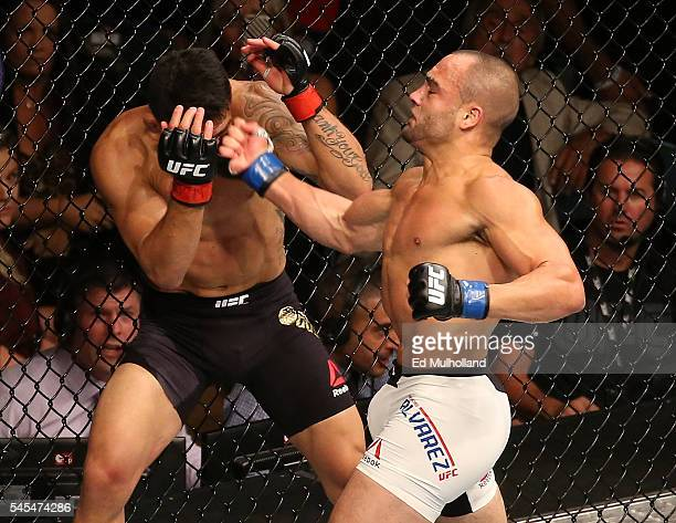 Eddie Alvarez punches Rafael Dos Anjos of Brazil during the UFC Fight Night event inside the MGM Grand Garden Arena on July 7 2016 in Las Vegas Nevada