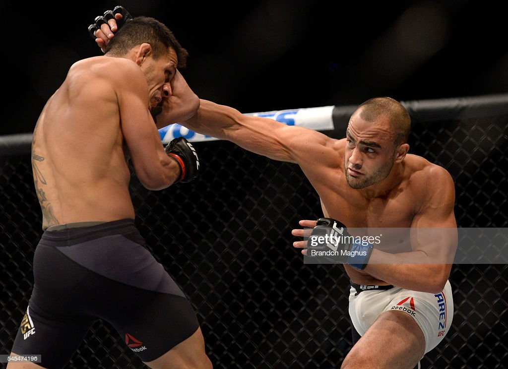 Eddie Alvarez punches Rafael Dos Anjos of Brazil in their lightweight championship bout during the UFC Fight Night event inside the MGM Grand Garden Arena on July 7, 2016 in Las Vegas, Nevada.