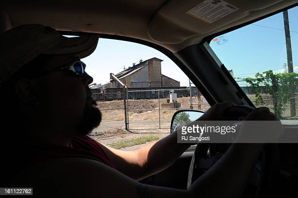 COLOSTEEL13 Eddie Barela who was recently laid off drives pass the mill where he worked in Pueblo Colorado steelworkers like Barela are battling with...