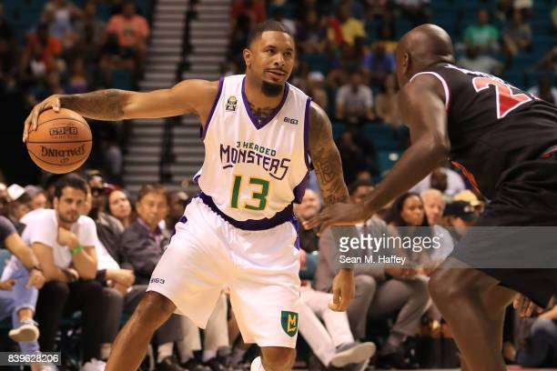 Eddie Basden of 3 Headed Monsters drives with the ball against Dion Glover of Trilogy during the BIG3 three on three basketball league championship...