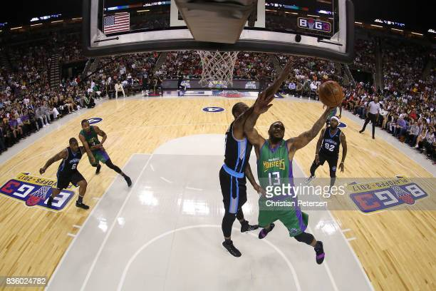 Eddie Basden of the 3 Headed Monsters attempts a lay up in front of Rasual Butler of the Power in week nine of the BIG3 threeonthree basketball...